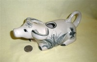 Kneeling water buffalo cow creamer