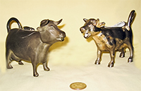 Old Colony Pewter and Japanese silver colored cow creamers