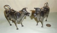 2 electroplated nickel silver cow creamers by PT&Co, front