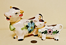 2 white cows with flowers