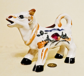 LLarge standing Japanese cow with farm scene on left