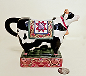 Colorful Jim Shore cow creamer on square base