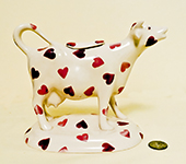 Emma Bridgewater Pink Hearts cow creamer on base