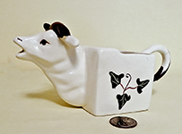 square bodies cow creamer wityh ivy decorations