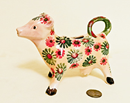 Small Italian cow creamer with flowers by Modigliani