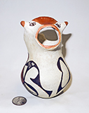Acoma cow with rainbird, front