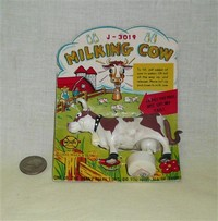 Milking cow plastic toy in placard by Loui Marx