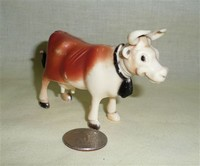 Browh and white small plastic milying cow toy
