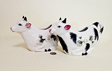 Two kneeling Italian cow creamers with raised flowers made for Meiselman