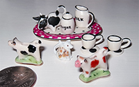dollhouse sized cow creamers