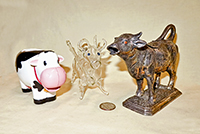 Plastic, metal and glass cow creamers