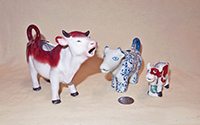 Realistic and fanciful cow creamers