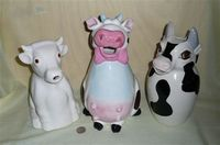 3 large cow pitchers
