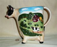 Baum Bros. cow pitcher with farm scene on side