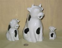 Stonewall Kitchen cow pitcher and two creamers