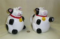 Pudgy black & white cow pitcher and teapot