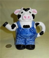 Farmer in blue overalls cow pitcher
