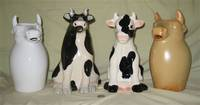 4 more large sitting cow pitchers