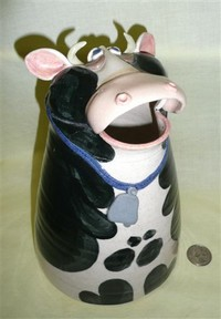 Large mouthed hand made cow pitcher, front