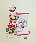 Judy Lotus Cow in red dress holding milk carton container, front