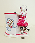 Judy Lotus Cow in red dress holding milk carton container, back