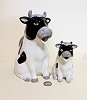 Henriuckson imports cow pitcher and creamer with greyk noses