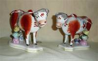Pair of Victorian cow creamers withy milkmaids