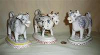 Three Kent style cow creamers