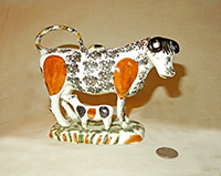Orange flanks and black sponge cow with calf
