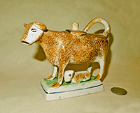 Brown spatter-painted cow creamer