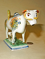 Multicolored sponged cow creamer with long yellow horns, front