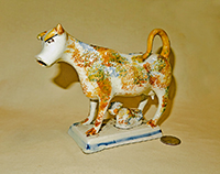 Multi-colored sponge painted cow creamer