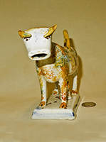 Multi-colored sponge painted cow creamer, front