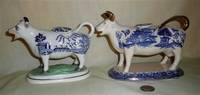 Two Blue Willow transfer printed cow creamers, left