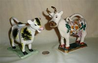 2 unusual cow creamers from the UK