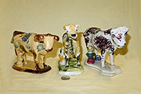 Three cow creamers with milkmaids