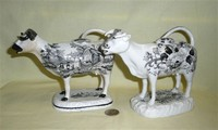 Glamorgan and Cambrian transfer printed cow creamers, left