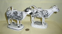 Glamorgan and Cambrian transfer printed cow creamers, right