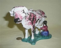 Mean looking red and black sponged cow creamer with milkmaid