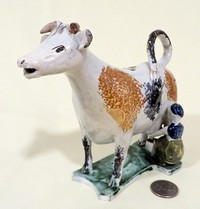 Cow creamer with 2 splatter marks and milkmaid