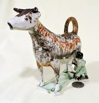 White & splatter painted Whieldon cow creamer with milkmaid