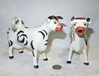 two very different Kent cow creamers