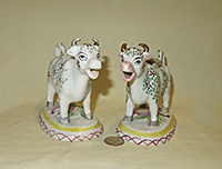 2 Kent style cow creamers with small flowers and leaves, front