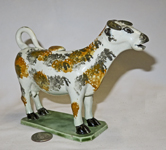 Multi-colored sponge painted dog faced cow creamer