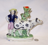 boy with cow spill vase