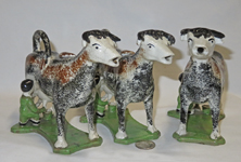 3 Multi-colored sponge painted  cow creamers