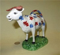 Swansea Cambrian cow creamer with brown horns