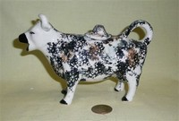 Kent stryle cow creamer, no base, with black and a bit of brown marks