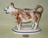 Kent style cow creamer with brown sponging