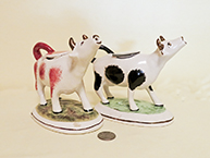 Pair of cow creamers with long nacks and raised heads